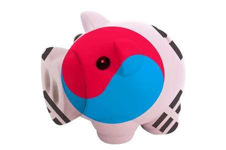 piggy rich bank in colors national flag of south korea for savings on white background photo