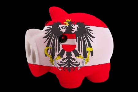 piggy rich bank in colorsnational flag of austriafor saving money on black background photo