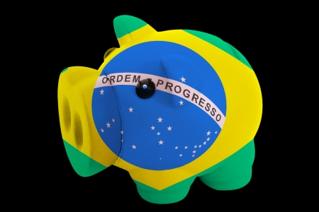 piggy rich bank in colorsnational flag of brazilfor saving money on black background photo