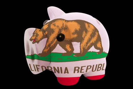 piggy rich bank in colorsflag of us state of californiafor saving money on black background photo
