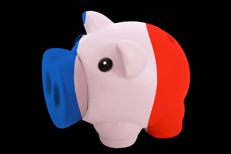 piggy rich bank in colorsnational flag of francefor saving money on black background photo