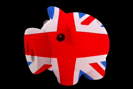 piggy rich bank in colorsnational flag of ukfor saving money on black background photo
