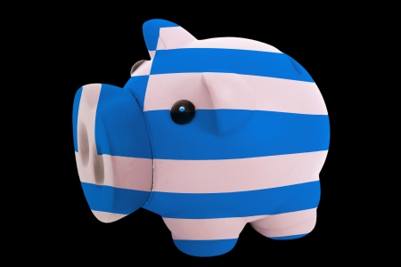 piggy rich bank in colorsnational flag of greecefor saving money on black background photo