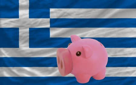 piktogramm: Piggy rich bank in front of national flag of greece symbolizing saving and accumulating funds as good financial habit Stock Photo