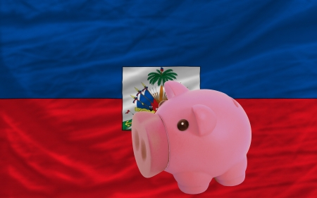 piktogramm: Piggy rich bank in front of national flag of haiti symbolizing saving and accumulating funds as good financial habit