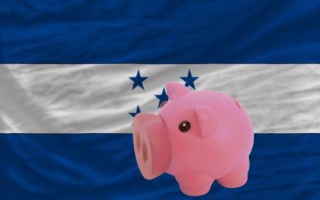 piktogramm: Piggy rich bank in front of national flag of honduras symbolizing saving and accumulating funds as good financial habit
