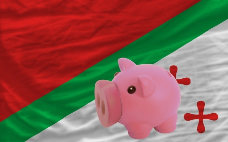 accumulating: Piggy rich bank in front of national flag of  katanga symbolizing saving and accumulating funds as good financial habit Stock Photo