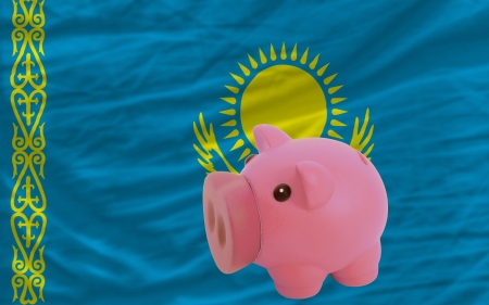 accumulating: Piggy rich bank in front of national flag of kazakhstan symbolizing saving and accumulating funds as good financial habit Stock Photo
