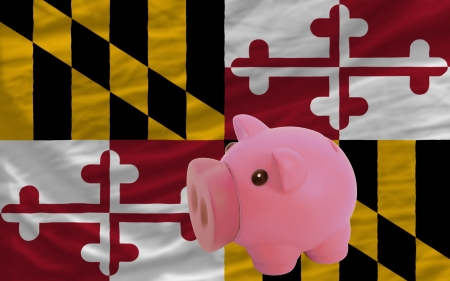 accumulating: Piggy rich bank in front of flag of us state of maryland symbolizing saving and accumulating funds as good financial habit Stock Photo