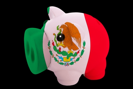 piggy rich bank in colorsnational flag of mexicofor saving money on black background photo