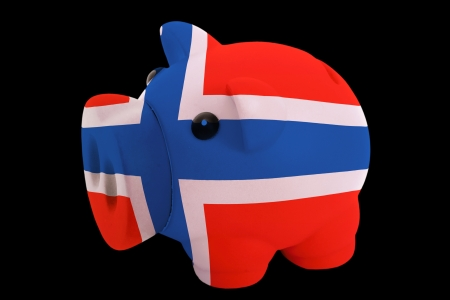 piggy rich bank in colorsnational flag of norwayfor saving money on black background photo