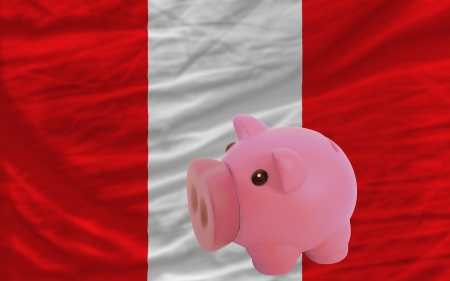piktogramm: Piggy rich bank in front of national flag of peru symbolizing saving and accumulating funds as good financial habit Stock Photo