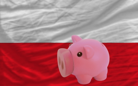 accumulating: Piggy rich bank in front of national flag of poland symbolizing saving and accumulating funds as good financial habit Stock Photo