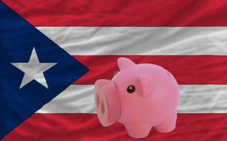 puertorico: Piggy rich bank in front of national flag of puertorico symbolizing saving and accumulating funds as good financial habit Stock Photo