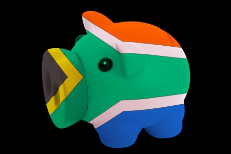 piggy rich bank in colorsnational flag of russiafor saving money on black background photo