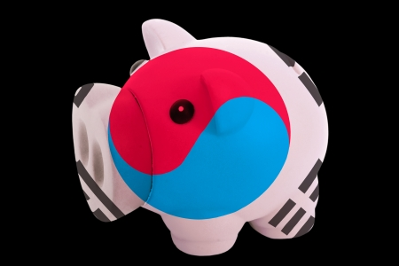 piggy rich bank in colors national flag of south korea for saving money on black background photo