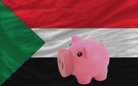 accumulating: Piggy rich bank in front of national flag of sudan symbolizing saving and accumulating funds as good financial habit Stock Photo