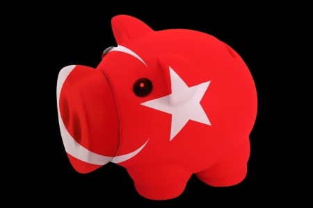 piggy rich bank in colorsnational flag of turkeyfor saving money on black background photo