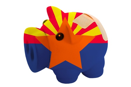 epty poor man piggy rich bank in colorsflag of us state of arizona on white