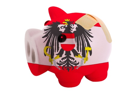 epty poor man piggy rich bank in colorsnational flag of austria on white photo