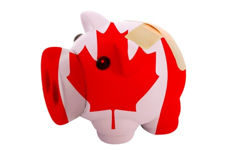 epty poor man piggy rich bank in colorsnational flag of canada on white photo