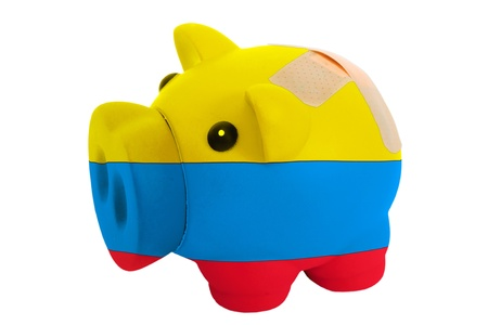 epty poor man piggy rich bank in colorsnational flag of columbia on white Stock Photo - 18405287