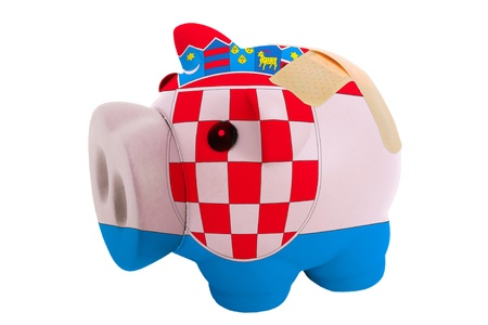 epty poor man piggy rich bank in colorsnational flag of croatia on white photo
