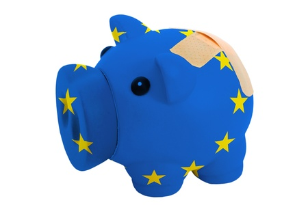 epty poor man piggy rich bank in colorsnational flag of europe on white photo