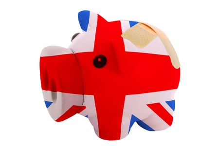 epty poor man piggy rich bank in colorsnational flag of uk on white photo