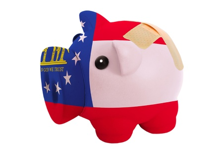 epty poor man piggy rich bank in colorsflag of us state of georgia on white photo