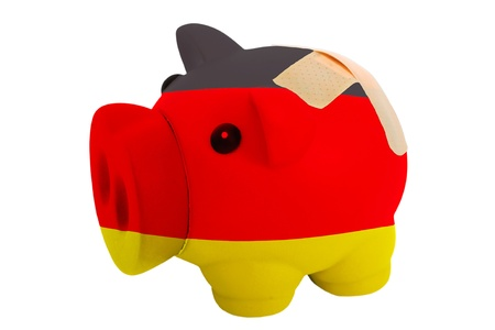 epty poor man piggy rich bank in colorsnational flag of germany on white photo