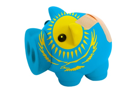 epty poor man piggy rich bank in colorsnational flag of kazakhstan on white Stock Photo - 18415354