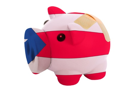 puertorico: epty poor man piggy rich bank in colorsnational flag of puertorico on white Stock Photo