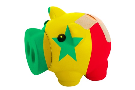 epty poor man piggy rich bank in colorsnational flag of senegal on white Stock Photo - 18415300