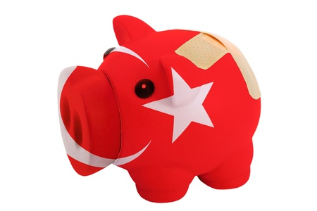 epty poor man piggy rich bank in colorsnational flag of turkey on white photo