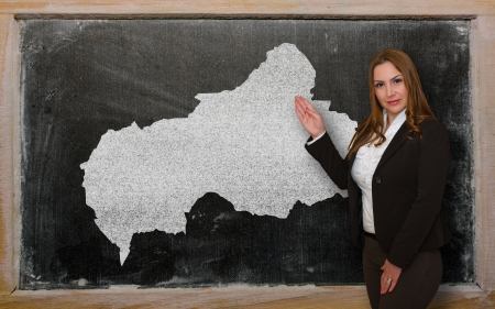 Successful, beautiful and confident young woman showing map of central african republic on blackboard for presentation, marketing research and tourist advertising photo