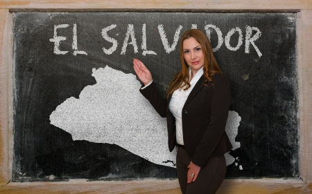 el salvador: Successful, beautiful and confident young woman showing map of el salvador on blackboard for presentation, marketing research and tourist advertising