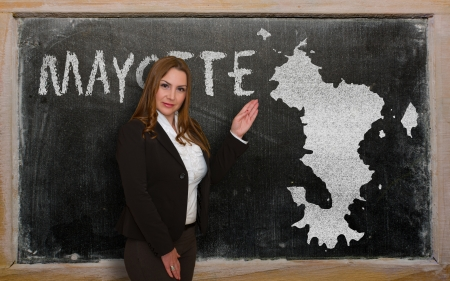 mayotte: Successful, beautiful and confident young woman showing map of mayotte on blackboard for presentation, marketing research and tourist advertising