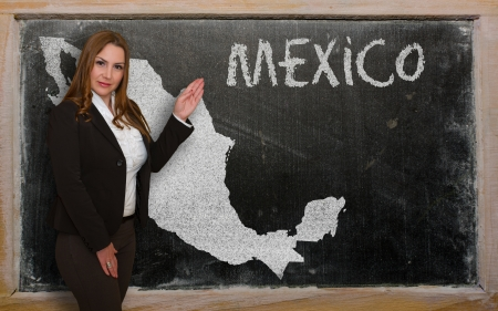 Successful, beautiful and confident young woman showing map of mexico on blackboard for presentation, marketing research and tourist advertising photo