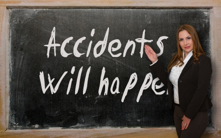 Successful, beautiful and confident woman showing Accidents will happen on blackboard