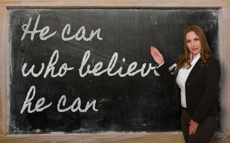 Successful, beautiful and confident woman showing He can who believes he can on blackboard Stock Photo - 18417028