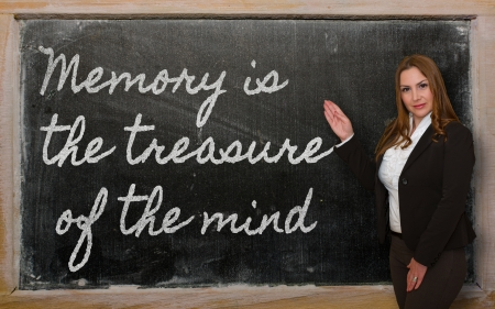 Successful, beautiful and confident woman showing Memory is the treasure of the mind on blackboard Stock Photo - 18416941