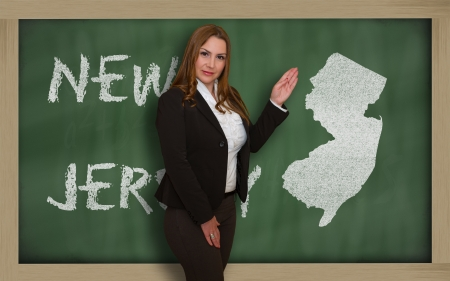 jersey: Successful, beautiful and confident young woman showing map of new jersey on blackboard