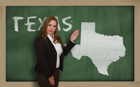 Successful, beautiful and confident young woman showing map of texas on blackboard