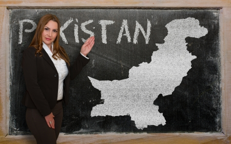 pakistani: Successful, beautiful and confident young woman showing map of pakistan on blackboard for presentation, marketing research and tourist advertising