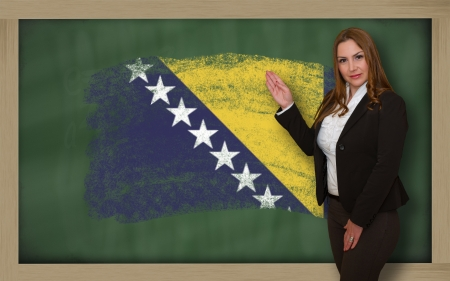 bosnia and  herzegovina: Successful, beautiful and confident woman showing flag of bosnia herzegovina on blackboard for marketing research, presentation and tourist advertising Stock Photo