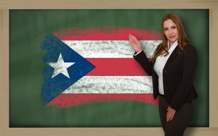 puertorico: Successful, beautiful and confident woman showing flag of puertorico on blackboard for marketing research, presentation and tourist advertising Stock Photo
