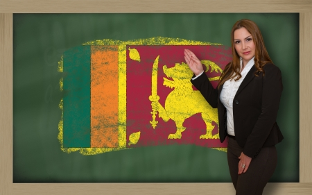 srilanka: Successful, beautiful and confident woman showing flag of srilanka on blackboard for marketing research, presentation and tourist advertising