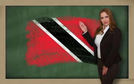 trinidadian: Successful, beautiful and confident woman showing flag of trinidad tobago on blackboard for marketing research, presentation and tourist advertising Stock Photo