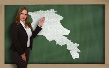 map of armenia: Successful, beautiful and confident young woman showing map of armenia on blackboard for presentation, marketing research and tourist advertising Stock Photo